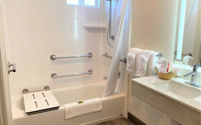 Santa Monica hotel room with queen bed and accessible bath with bathtub